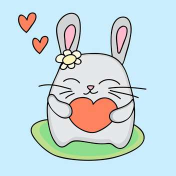 Lovely rabbit holds love heart in hands - vector gratuit #127265