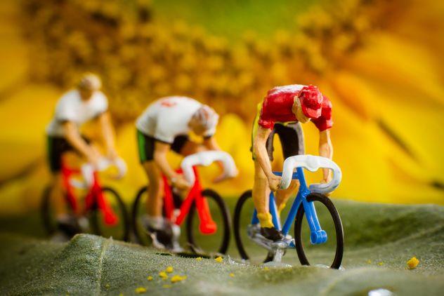 Miniature cyclists on green leaf - Free image #136365