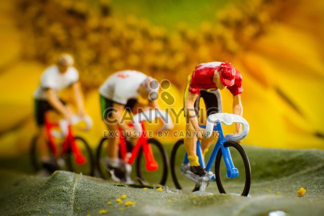 Miniature cyclists on green leaf - Free image #136365