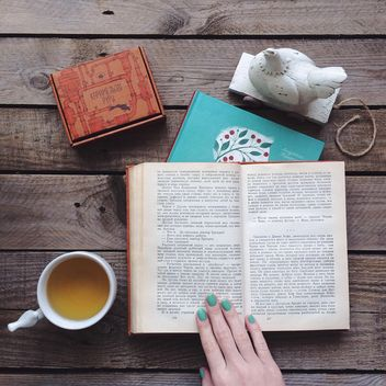 Cup of tea, candies and open book - image #136535 gratis