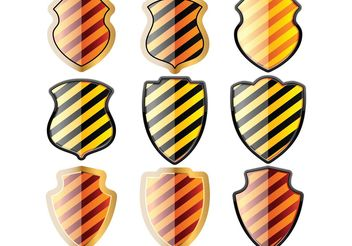 Free set of of shields in black and yellow stripes - vector gratuit #139455