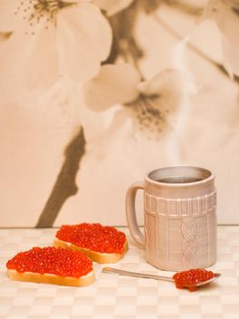 Sandwiches with red caviar and cup of tea - image #182535 gratis
