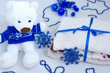 Teddy bear, warm clothing and Christmas decorations - image gratuit #182555