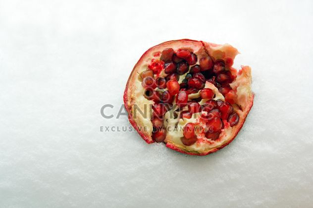 Fresh peeled pomegranate in snow - Free image #182655