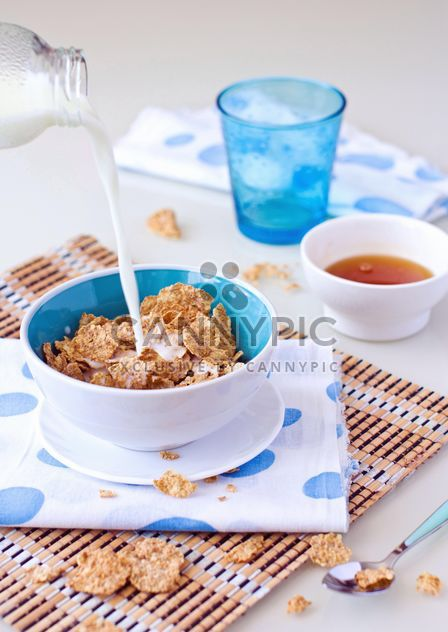 Cereals and milk for breakfast - Free image #182715