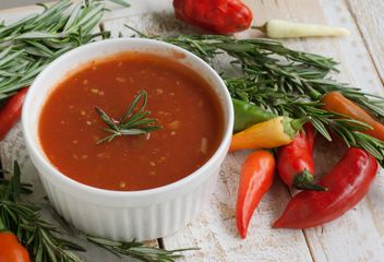 tomato sauce with rosemary and chili peppers on a wooden table - Free image #183365