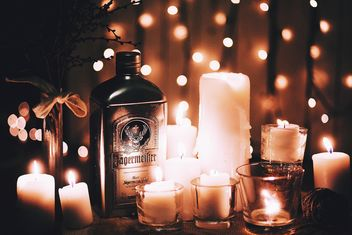 Candles and bottle of alcohol - image #183745 gratis