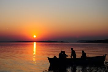 silhouettes of fishermen on lake - Free image #185775
