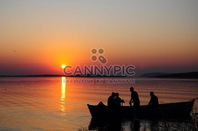 silhouettes of fishermen on lake - Free image #185775
