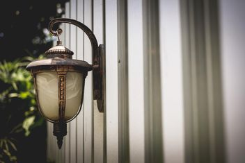 Vintage lantern on wall - image #186095 gratis