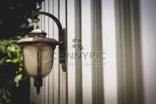 Vintage lantern on wall - Free image #186095