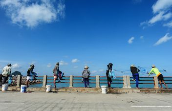 Fishermen on the bridge - Free image #186425