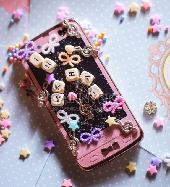 Smartphone con elementos decorativos - image #187245 gratis