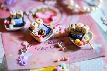 wooden letters and beads on the background of books - image #187255 gratis