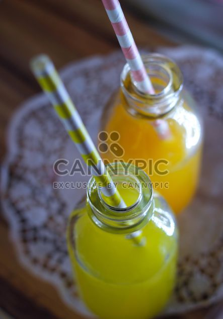 Bottles of lemon and orange juices - Free image #187635