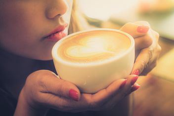 Woman drinking coffee latte - Free image #197915