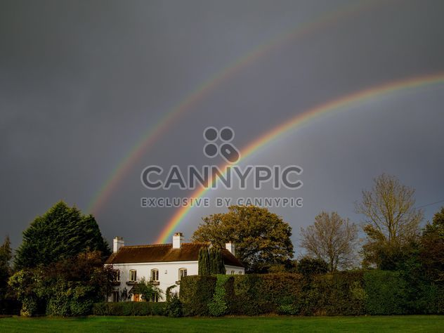 Landscape with rainbow over house - Free image #198235