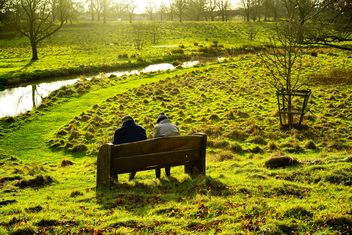 people sitting on a bench - Free image #198245
