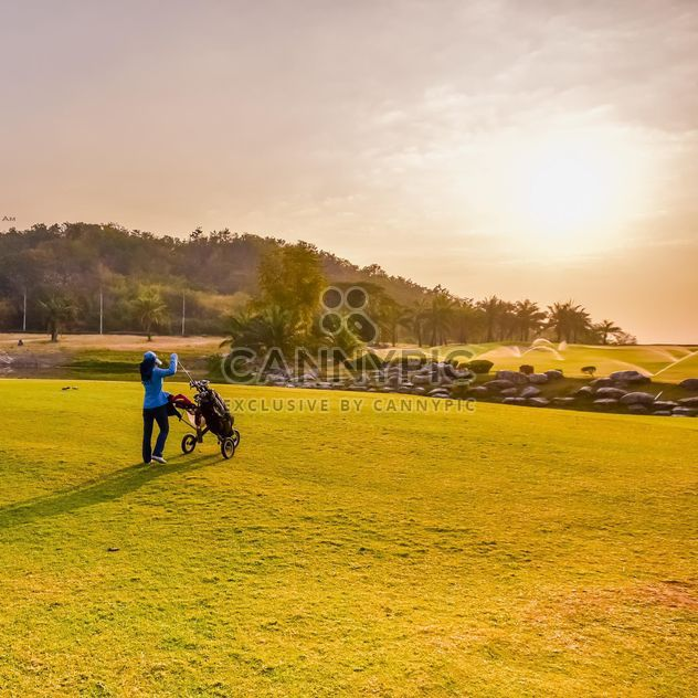 Woman with golf bag at course - Free image #198335