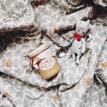 Jar of peanut butter and cute toy with spoon - бесплатный image #198385