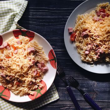 Two portions of pasta with cheese and tomato - image #198515 gratis