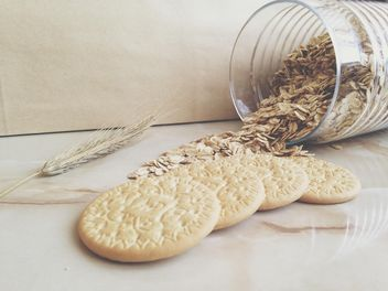 cookies and glass bank with oatmeal - image #198715 gratis