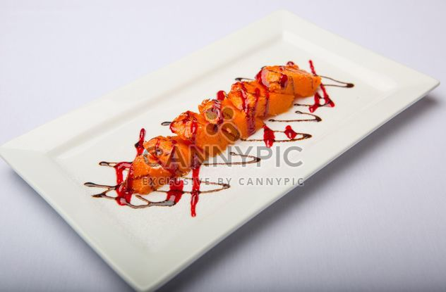 Dish of pumpkin on the plate on white background - Free image #198725