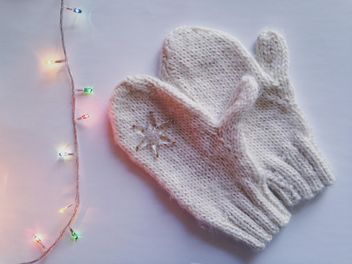 Mittens and garland on white background - бесплатный image #198775