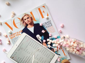 Magazine, tablet computer and marshmallows on white background - бесплатный image #198885