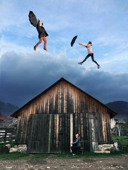 Boy looking at the girl and guy flying with umbrellas over the wooden house, #mylook - бесплатный image #271695