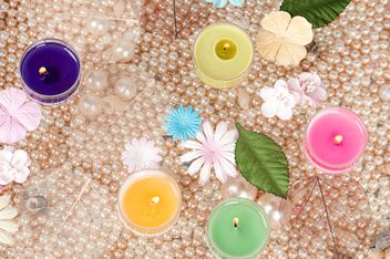 Colored candles, pearls and decorative flowers - image #272545 gratis