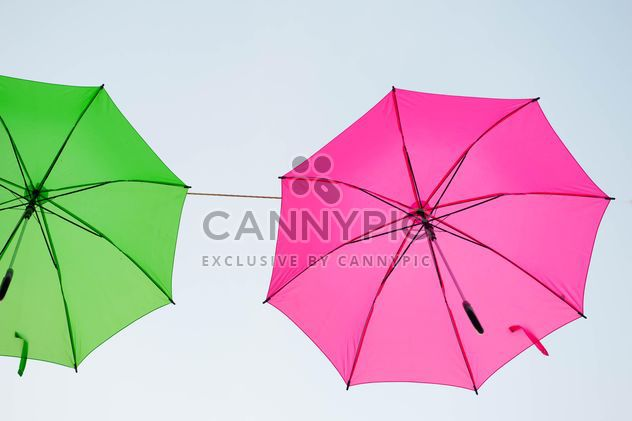 Green and pink umbrellas hanging - Free image #273065