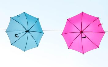 Blue and pink umbrellas hanging - image gratuit(e) #273075