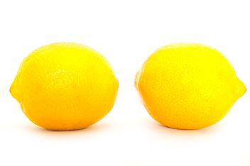 Two lemons isolated on white background - бесплатный image #273185