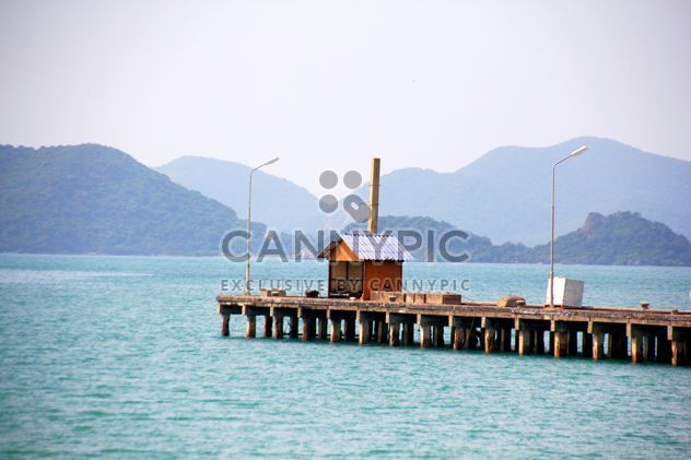 Wooden pier in the sea and mountains on the background - Free image #274805