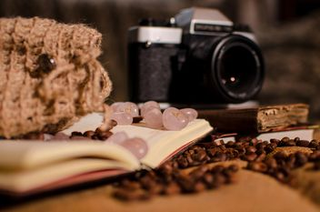 Old camera, books, runes and coffee beans - image #275325 gratis
