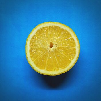 Lemon on blue background - бесплатный image #301355