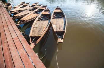Wooden boats on a pier - бесплатный image #301455