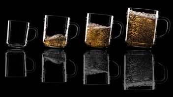 Glass cups on black background - image gratuit #303225
