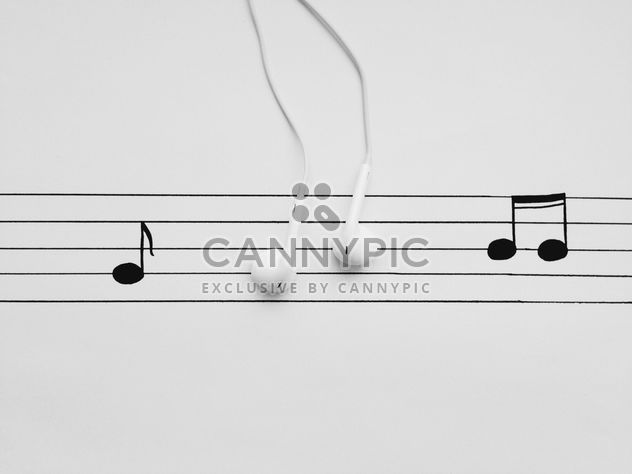 Earphones and notes on white background - Free image #304105