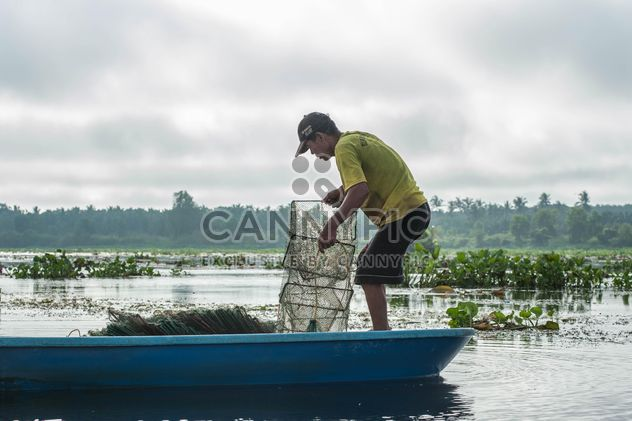 Fisherman on a boat - Free image #304585