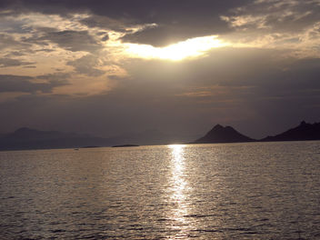 Turkey (Bodrum) Sun behind the black clouds - бесплатный image #305345