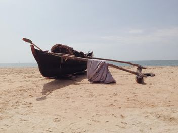 fishing boat at the beach - бесплатный image #317395