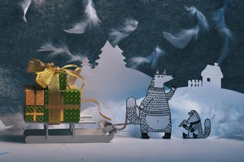 Paper foxes with gifts on sledge in winter - Free image #327305
