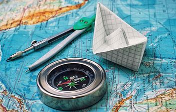 Compass and paper boat on the map - Free image #327335