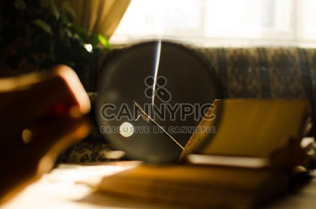 Autumn yellow leaves through a magnifying glass and incense sticks and book - Free image #330415