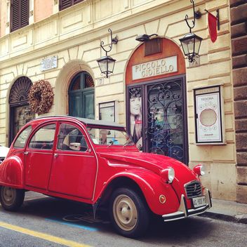 Red Citroen car in the street - image gratuit #331895