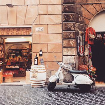 Retro Vespa scooter in street of Rome - image #332275 gratis