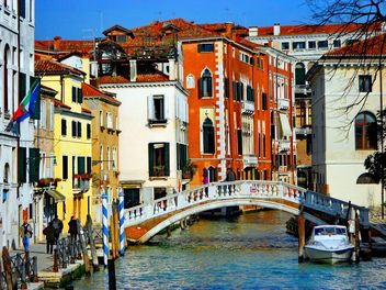 Gondolas on canal in Venice - image #333675 gratis