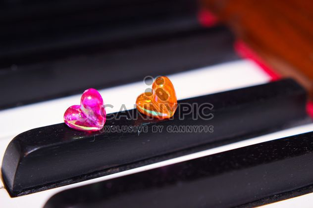Closeup of piano decorated with tiny hearts - Free image #341475